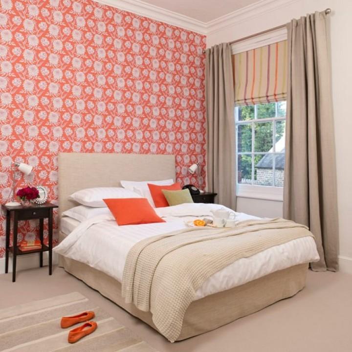 Oživte svoji ložnici oranžovou barvou